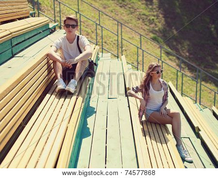Cool Hipster Couple Resting On The Bench, Youth, Teenagers, Fashion - Concept