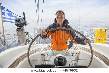 Young man sailing in the Sea. Yacht skipper. Sailing. Luxury yachts.