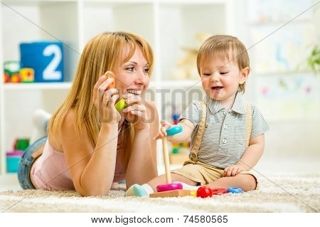 parent and kid boy playing together indoor