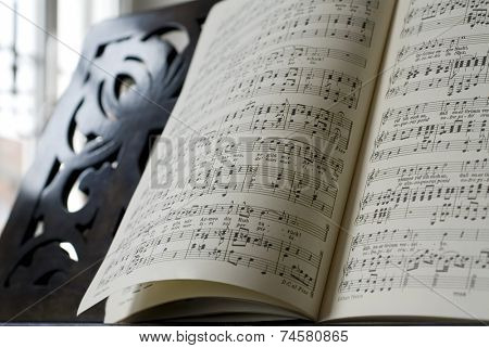 Grand Piano and lyrics book, focus on notes