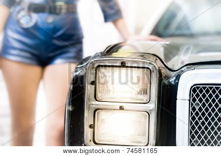 Policewoman Leaning On The Old Police Car.