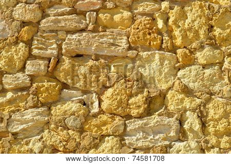 The irregular shapes of a Sandstone wall in Portugal