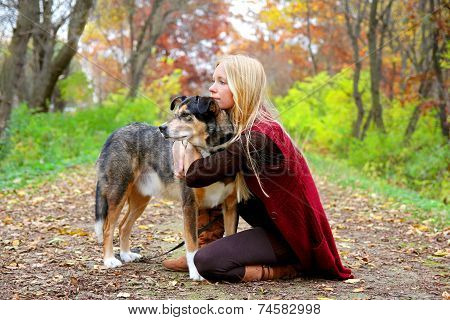Womann Woods And Pet Dog Relaxing In Woods In Autumn