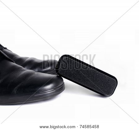 Black Leather Shoes And Sponge