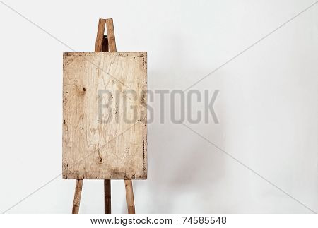 Blank Grunge Easel In A Light Room