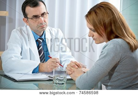 young woman in a conversation with the psychologist