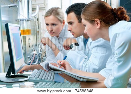 group of scientists working at the laboratory