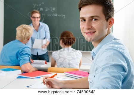 group of students  while studying in classroom
