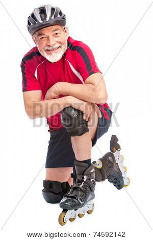 senior man goes inline skating
