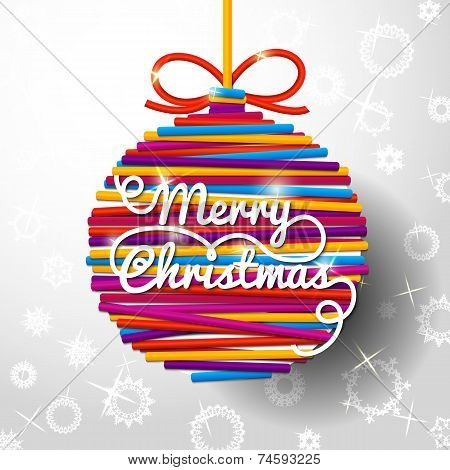 Merry Christmas handwritten swirl lettering greeting card on bright lace ball, paper background with