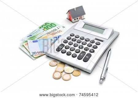 House, calculator and money isolated on white background
