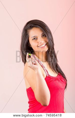Young hispanic brunette girl eating delicious candy sweets