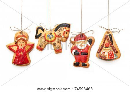 Gingerbread cookies hanging  isolated over white background