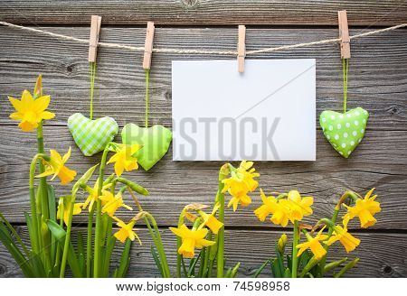 Message and hearts on the clothesline against wooden background