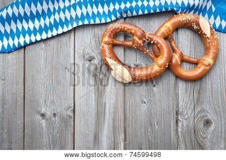 Appetizing pretzels with a bavarian flag  on wooden background