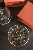 pic of bonbon  - Chocolate bonbons in dish and cocoa on background - JPG