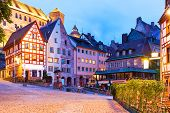 picture of timber  - Scenic summer night view of the Old Town medieval architecture with half - JPG