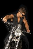pic of vest  - A man sitting on his motorcycle with his black vest and sunglasses - JPG