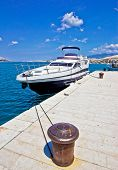stock photo of bollard  - Yacht on mooring bollard dock vertical view - JPG