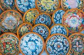 stock photo of keepsake  - Detailed view of some typical and coloured souvenirs of Syracuse - JPG
