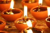 stock photo of diwali lamp  - traditional oil lamps in a row - JPG