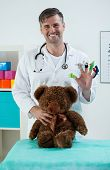 image of snellen chart  - Smiling pediatrician with toys in his office - JPG