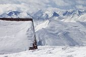 stock photo of snow capped mountains  - Hotel in snow and ski slope - JPG