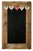 stock photo of wooden pallet  - Chalkboard christmas restaurant menu board reclaimed pallet wooden frame and shabby chic tin heart decoration isolated on white with copy space - JPG