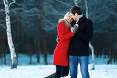 stock photo of lovers  - Lovely couple in love tenderness winter day - JPG