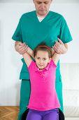 picture of chiropractor  - Chiropractor doing adjustment on female patient - JPG