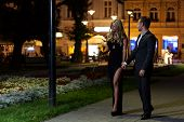 stock photo of night gown  - A handsome couple on a date night walk in the city  - JPG