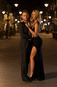 stock photo of night gown  - A beautiful woman and handsome man in a city at night - JPG