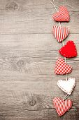 pic of cord  - Red hearts hanging over grey wood background - JPG