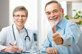 stock photo of observed  - Happy senior patient and doctor at the doctor - JPG