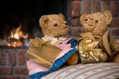 stock photo of cozy hearth  - Couple vintage teddy bears with christmas gifts in front of fireplace - JPG