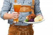 pic of lederhosen  - Food and drinks are served by waiter wearing traditional Bavarian leather trousers - JPG