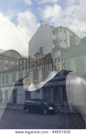 Houses Are Reflected In The Window With A Dummy In A Dress