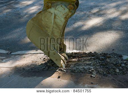 Excavator Bucket Destroys Asphalt.