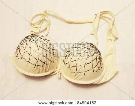 Light Yellow Bra Isolated On The White Background