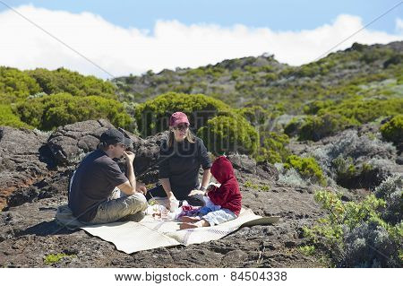 People have picnic at the Roche Plate volcanic rocks in Saint-Paul De La Reunion, France.