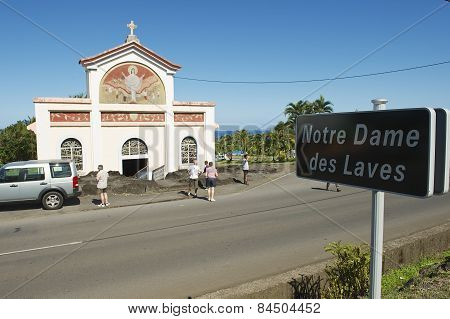 People explore the Notre dame des laves church in Sainte-Rose De La Reunion, France.