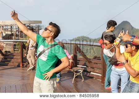 Tourists Taking Selfie Pictures On The Top Of Langkawi view point.