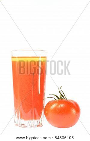 Red Tomato And A Glass Of Juice