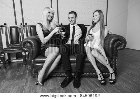 A guy and two girls in the room, tense.