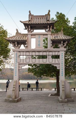 Old Traditional Chinese Stone Gate On Coast On West Lake