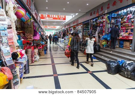 Interior Of Ordinary Chinese Clothing Market With People