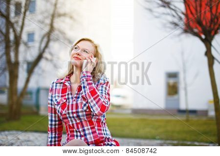 Young Businesswoman Calling Outdoor At Spring