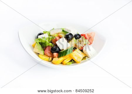Salad With Black Olives, Cucumber And Cheese On A White Background