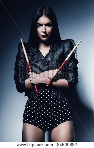 Sexy Drummer Woman In Black Jacket