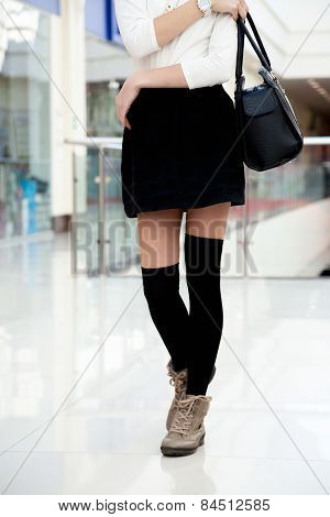 Young Female Walking In Fashionable Clothes Close Up On Legs
